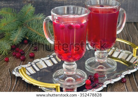 Red cranberry fruit drink two glasses on a tray. - stock photo