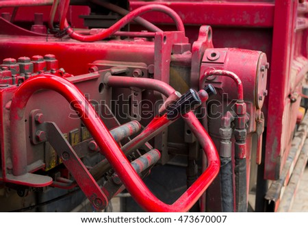 red crane of truck hydraulic control. selective focus