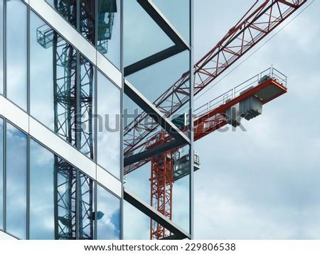 Red crane reflecting in a facade - stock photo