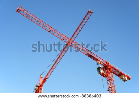 Red Cranes crossing at a construction site