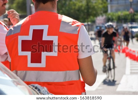 Red cross of Ambulance man on bicycles race - stock photo