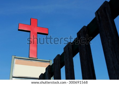red cross of church (welcome to jesus) - stock photo