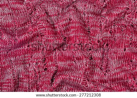 Red crumpled openwork melange stockinet as background texture  - stock photo