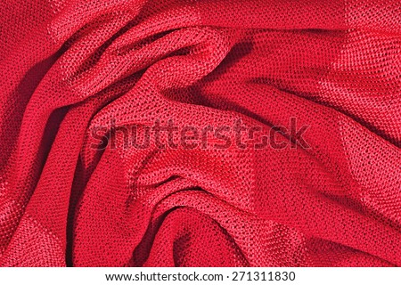 Red crumpled stockinet as background texture - stock photo