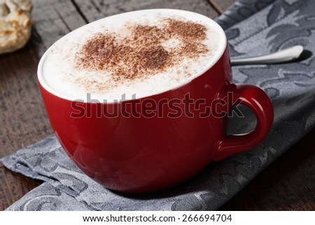 Red cup of Cappuccino Coffee