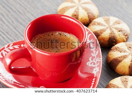 Red cup of coffee with biscuits, horizontal image - stock photo