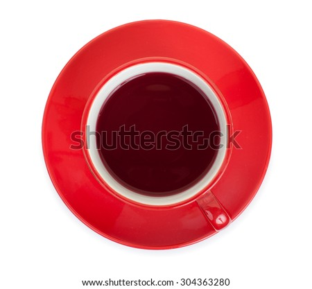 Red cup on a red saucer with red tea, isolated on a white background, top view. - stock photo