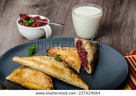 Red currant cheesecake-puzzle with mint and fresh milk - stock photo
