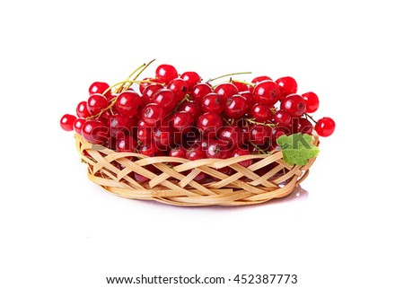 red currant in basket isolated on white background