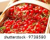 Red currant in basket, shallow depth of field - stock photo