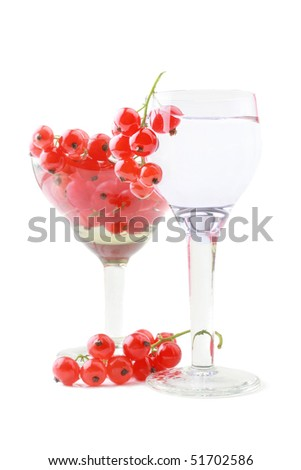 Red currant in the wineglass isolated on white background - stock photo