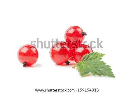Red currants with green leaf isolated over white background
