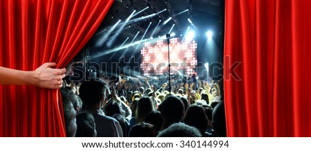 Red curtain on concert stage slightly open - stock photo