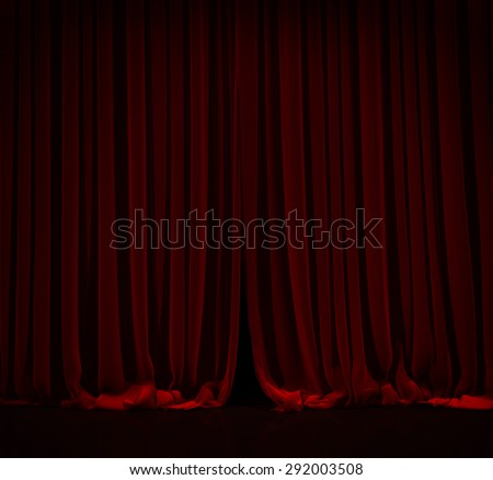 Red curtain with spot light on theater or cinema stage. - stock photo