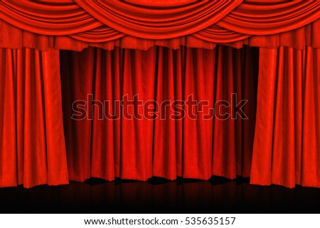 Red curtains and wooden stage floor