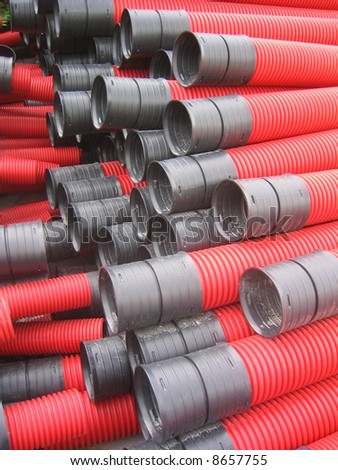 Red curvilinear tubes for construction - stock photo