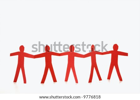 Red cutout paper men standing holding hands.