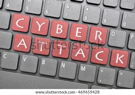 Red cyber attack key on keyboard
