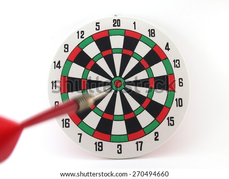 red dart arrow moving approaching to target center on bullseye in dartboard isolated on white background, darts motion straight into the goal, concept about success is not far away