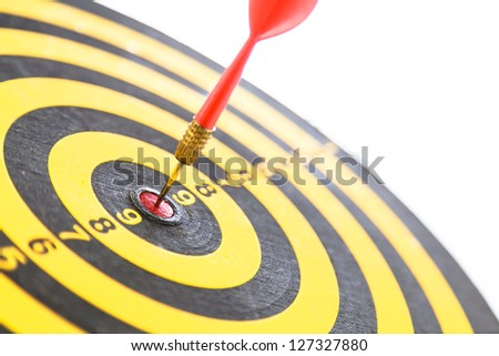 Red dart hitting a target, isolated on white - stock photo