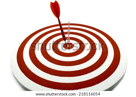 Red dart target with red arrow