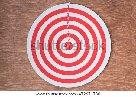 red dartboard on wood background