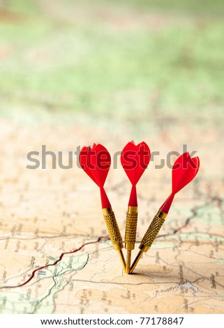 Red darts in a shallow focus map - stock photo