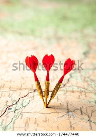 Red darts in a shallow focus roadmap - stock photo