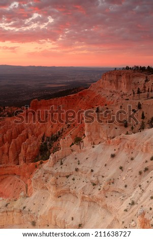 Red dawn sky above Bryce Canyon, Utah, USA.