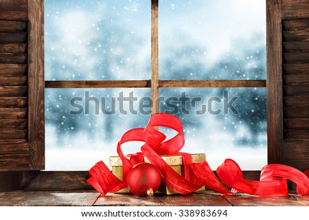 red decoration of ribbon and wooden window and winter day time  - stock photo