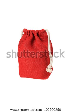 Red decorative rag bag with ropes for tying. Isolated on white. - stock photo