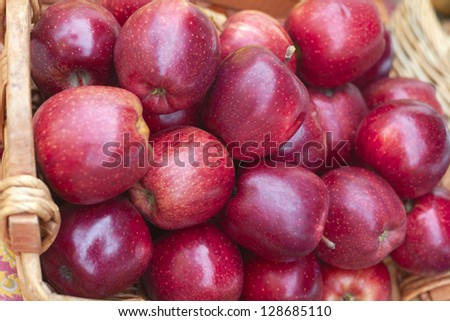 Red delicious apples for sale in basket at the market. Horizontal Shot. - stock photo