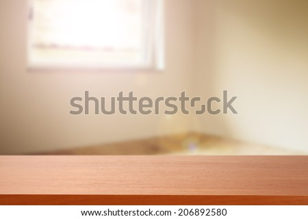 red desk and sunlight  - stock photo