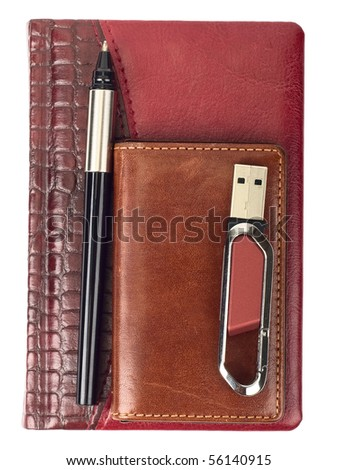 red diary with pencil and flash drive - stock photo