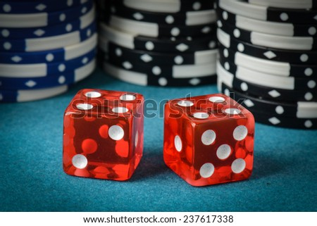 Red Dice and Playing Chips - stock photo