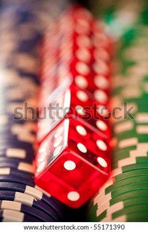 Red Dice on Blue and Green Poker Chips - stock photo