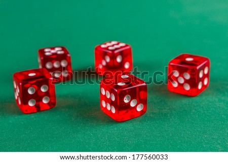 Red dice on green felt