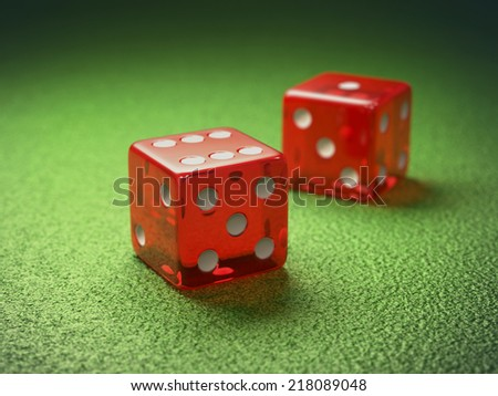 Red dice on green table gambling. Clipping path included. - stock photo