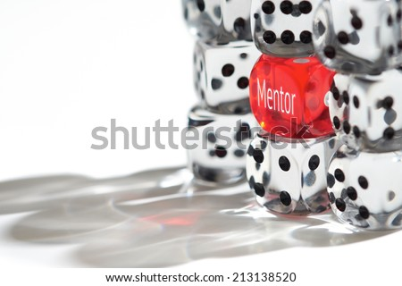 Red Dice Standing out from the crowd, Mentor concept. - stock photo