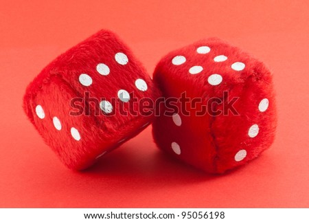 Red dices isolated on red background