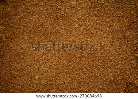 Red dirt (soil) background or texture.  - stock photo