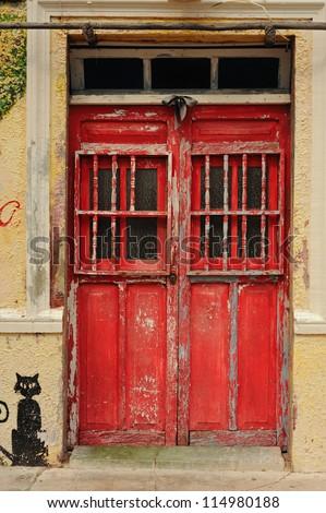 Red door and black cat - stock photo
