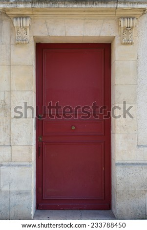 Red door in a Paris residential area - stock photo