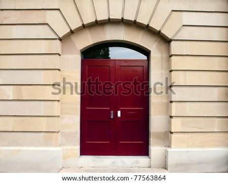 Red door in sandstone arch - stock photo