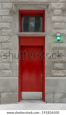 Red Door to an Urban Firehouse - stock photo