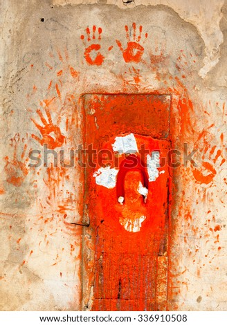 Red door with hands in Hindu temple, Rajasthan - stock photo