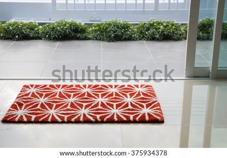 Red doormat - stock photo