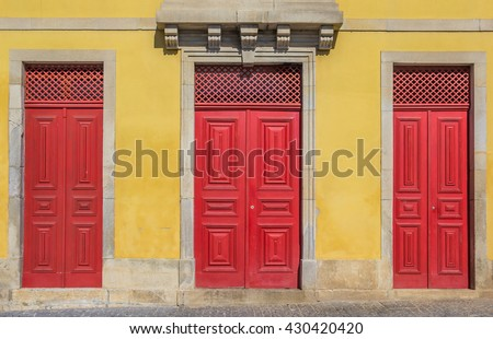 Red doors of an old house in Valenca do Minho, Portugal