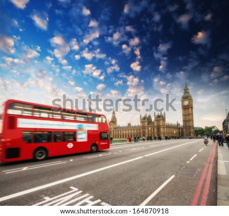 Red Double Decker Bus speeding up to Big Ben Tower on Westminster Bridge, London - UK. - stock photo