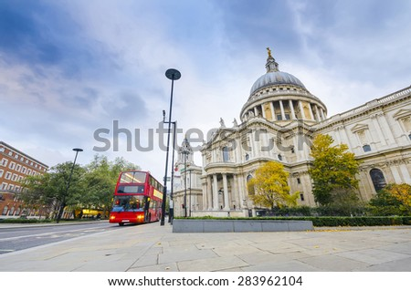 Red double decker bus stop at Saint Paul's Cathedral, London, England - stock photo